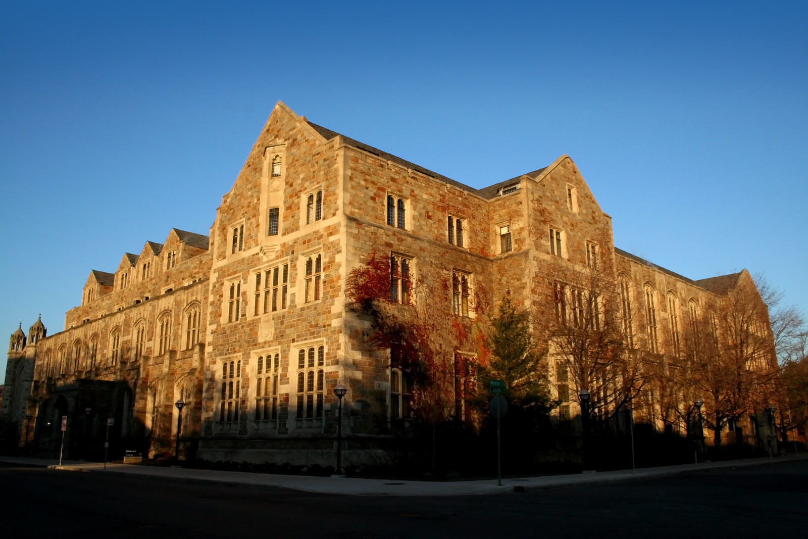 Historic brick building at the University of Michigan in Ann Arbor, in the gall with bare trees outlining the buiding