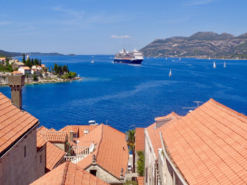 A Holland America cruise ship leaving a port in the Mediterranean