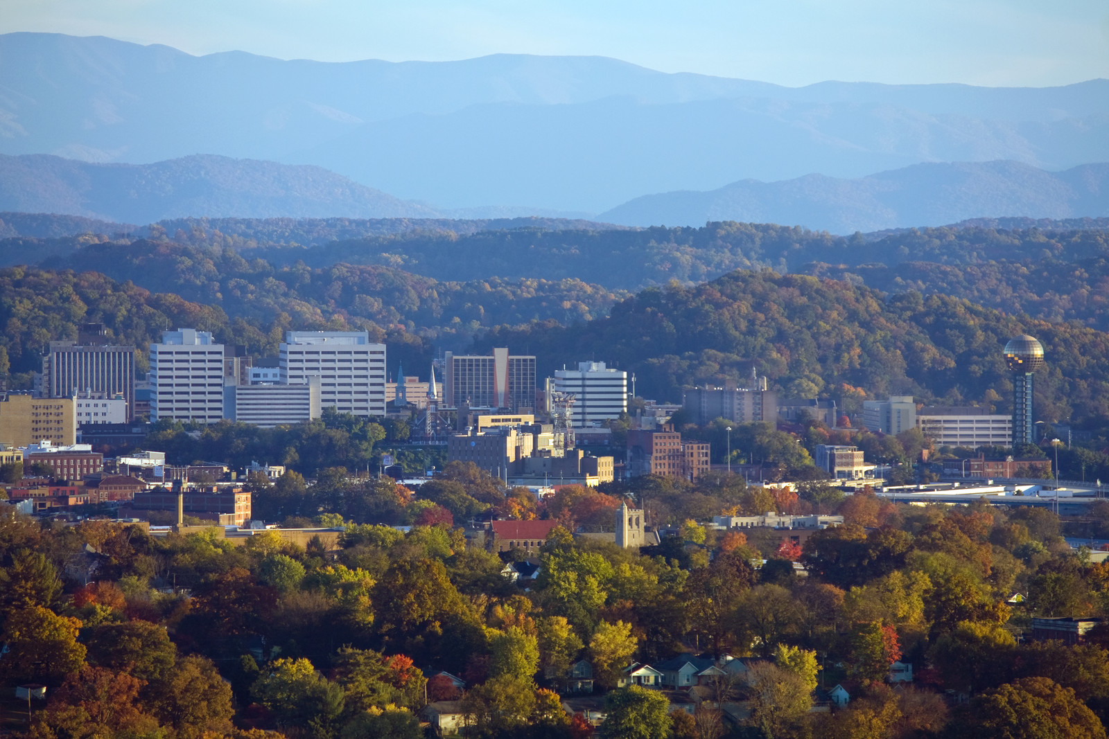 Best Places to Retire in Tennessee  - Knoxville Tennessee  skyline with the smoky mountains in the background