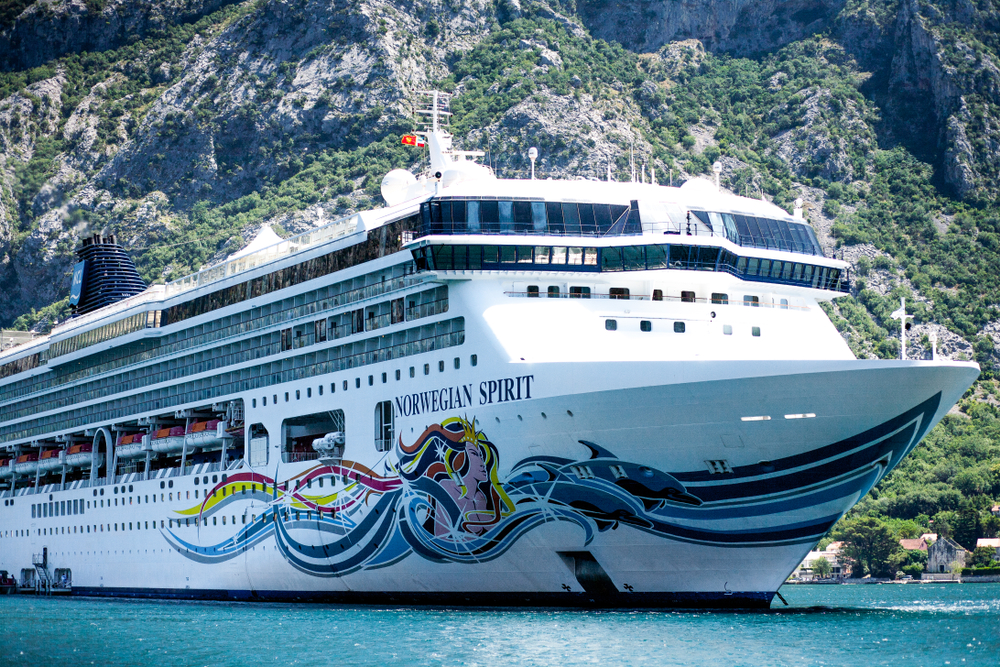 Norwegian Cruise Line in the Mediterranean with a mountain in the background