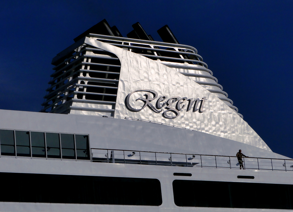 The funnel of a Regent cruise ship with lettering
