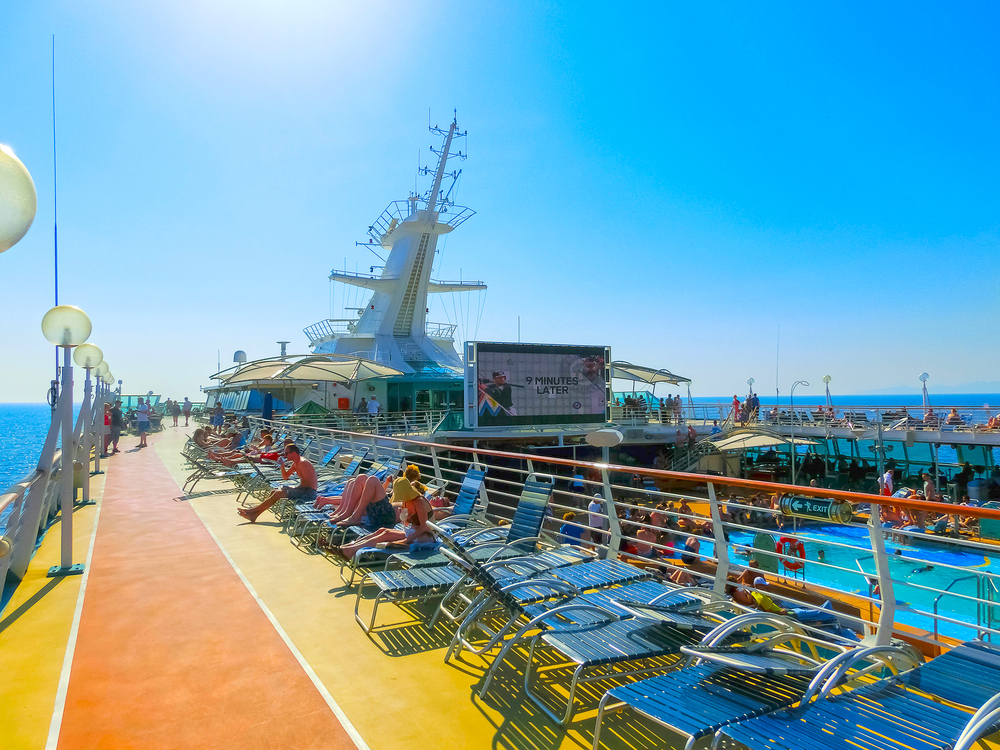 Deck of a Royal Caribbean cruise ship with bright colors and a pool
