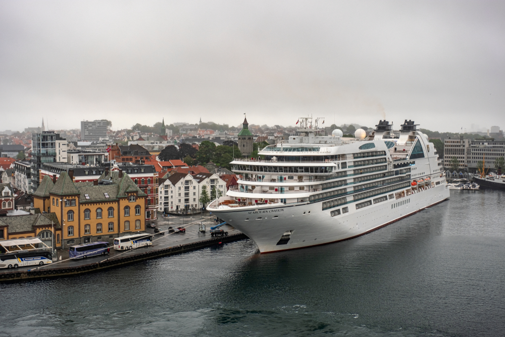 Seabourn cruise ship next to a Norwegian town