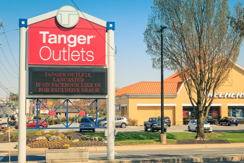 A Tanger Outlets sign outside of a shooping mall
