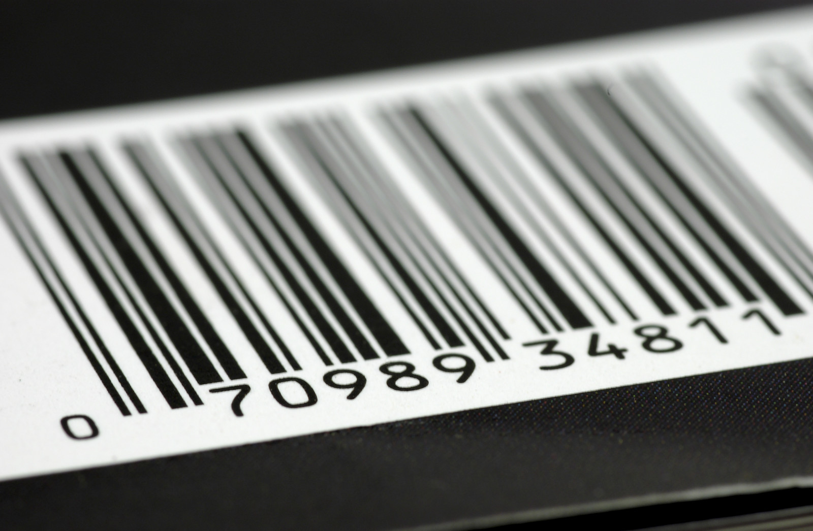 Black background with an up close shot of a bar code