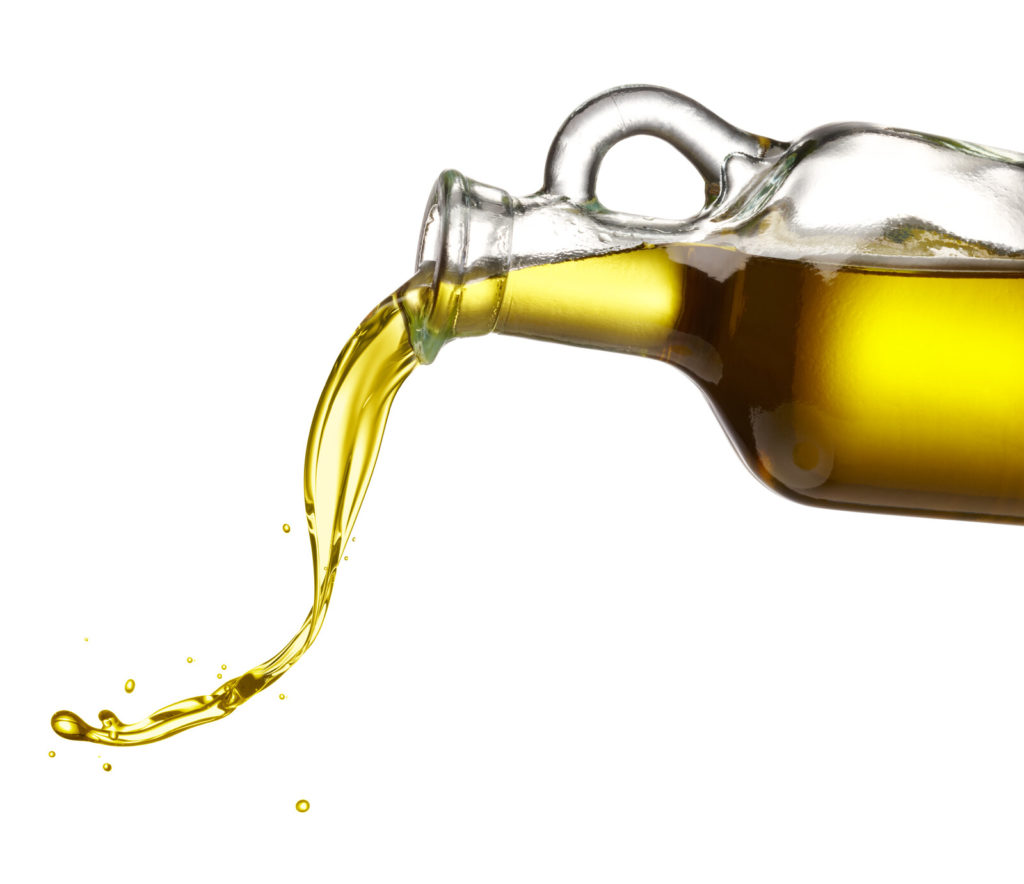 Olive oil pouring out of a jug