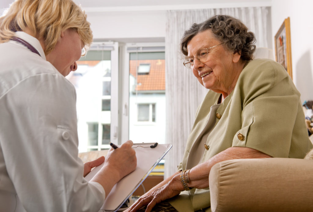 A senior talking to a doctor.