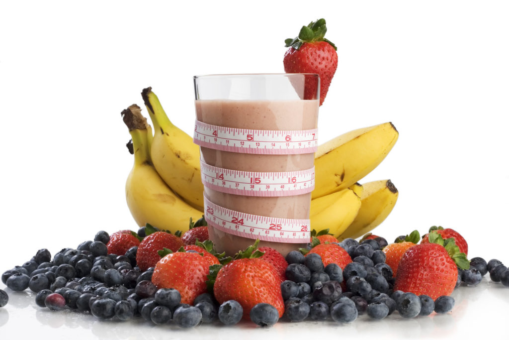 A smoothie with fruit.