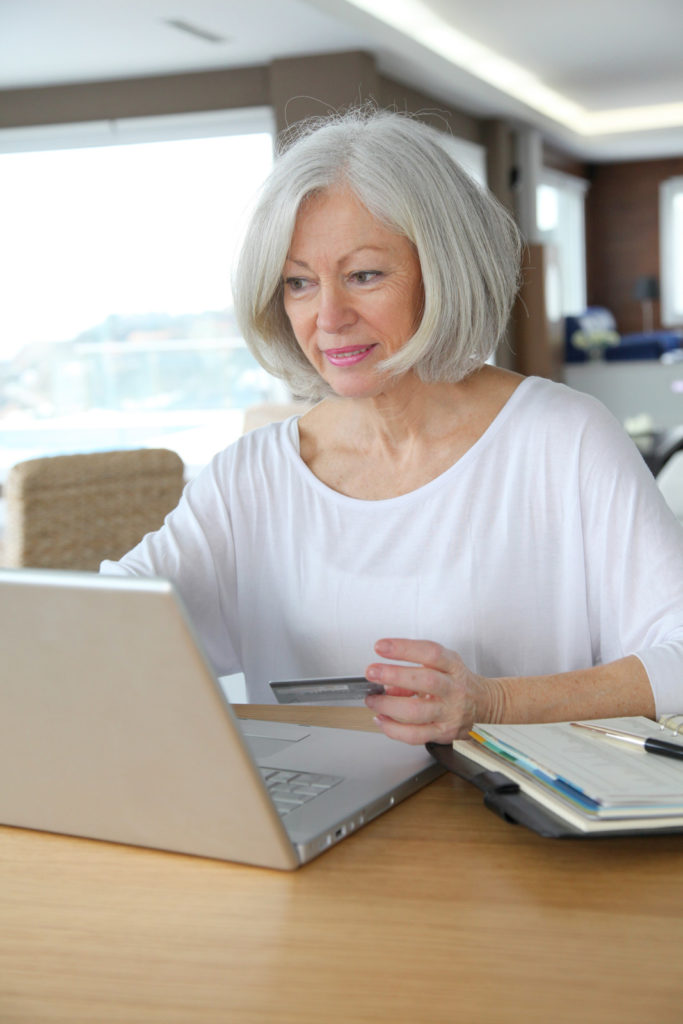 A woman shopping online at her desk.