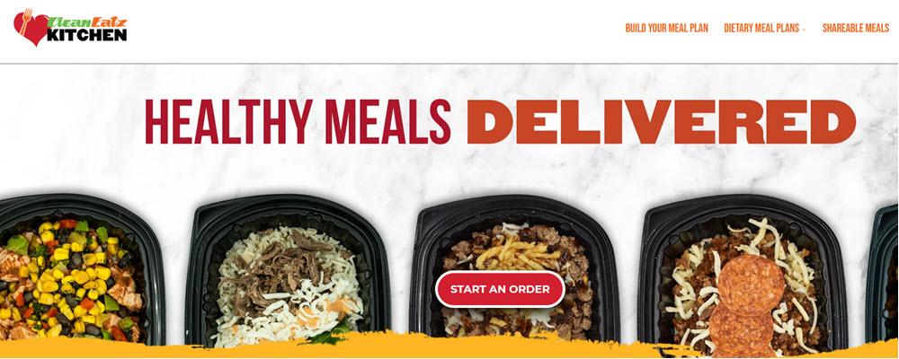 Clean Eatz Kitchen website screenshot showing five different meals in plastic containers