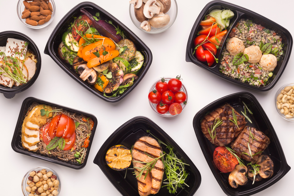 A selection of diabetic meals delivered to the home in black plastic containers