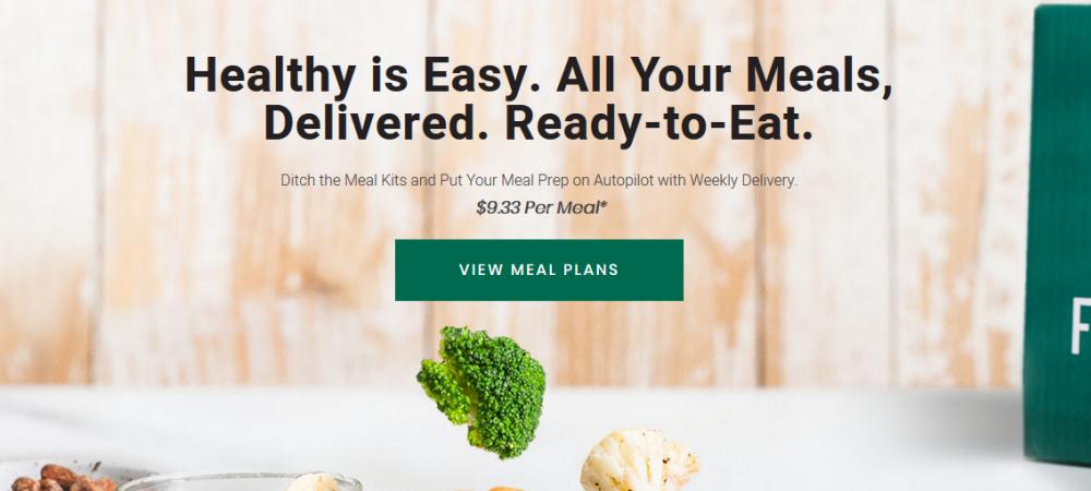 Fresh 'n Lean website screenshot showing fresh ingredients and a paneled background