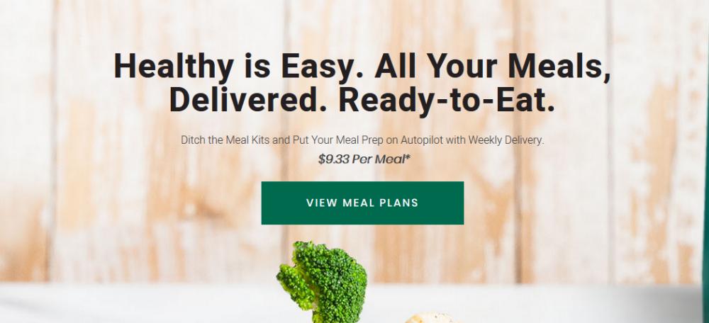 Fresh n Lean website screenshot showing fresh ingredients against a wooden background