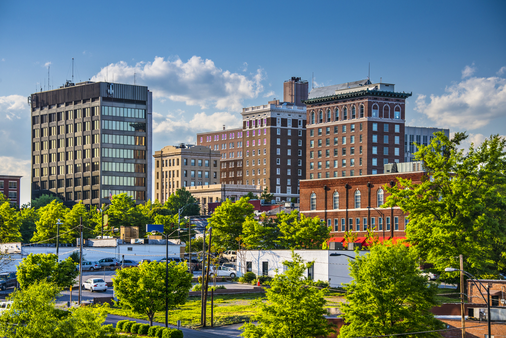 Downtown in Greenville South Carolina, showing tall buildings and lots of trees