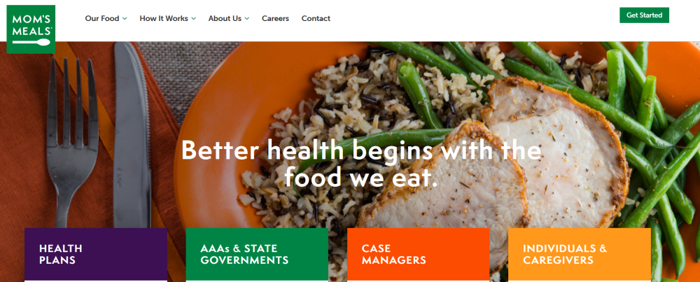 Moms Meals Website Screenshot showing a fresh plate of food with text overlaid