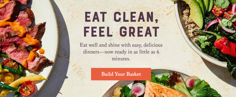 Sun Basket website screenshot showing partial images of three plates with fresh and healthy dinners