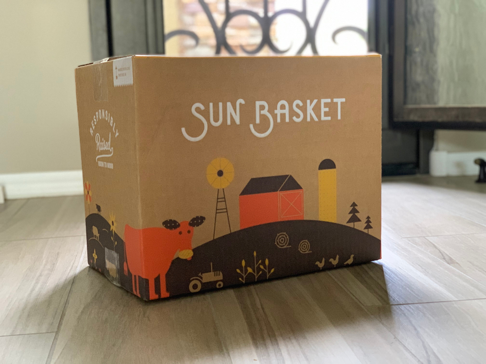 A box from Sun Basket in an entry way