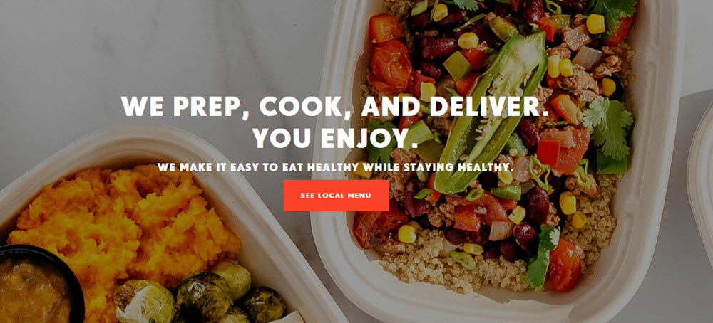 Territory website screenshot showing two cooked dinners in white plastic containers