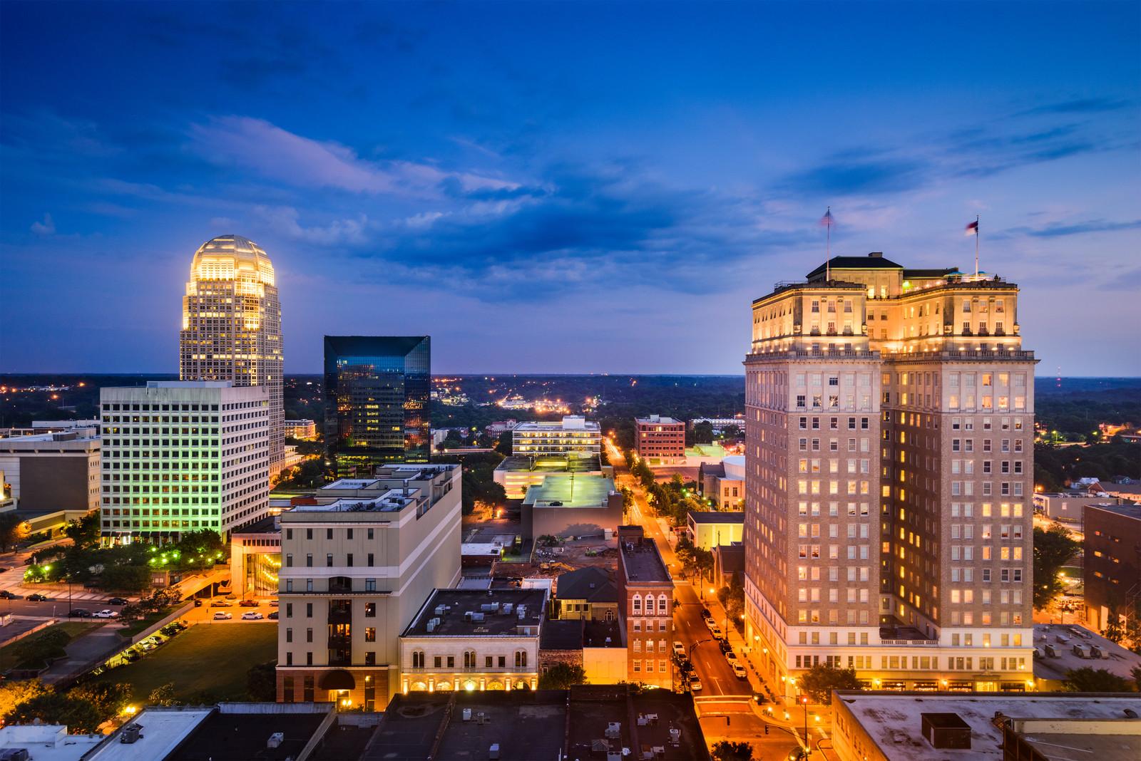 Winston-Salem, North Carolina, evening skyline with blue purple skies and lighted up buildings
