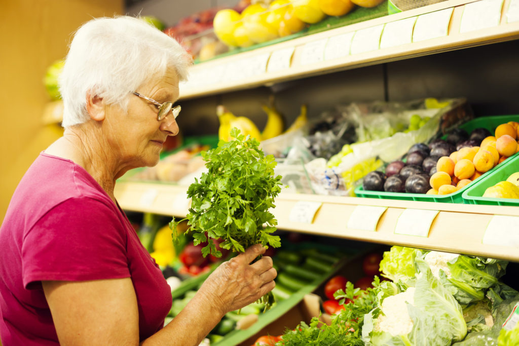 A senior woman at the grocery store.
