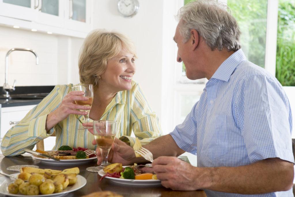 A senior couple enjoys a meal together.