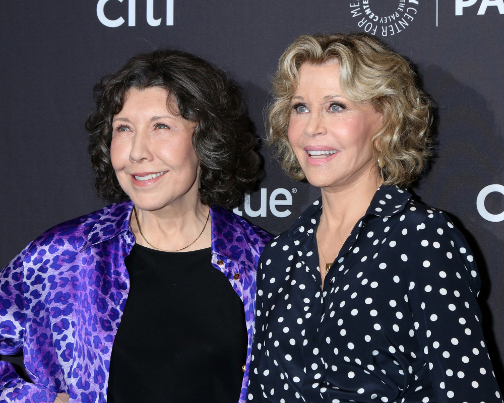The actresses from Grace and Frankie smiling for photographers