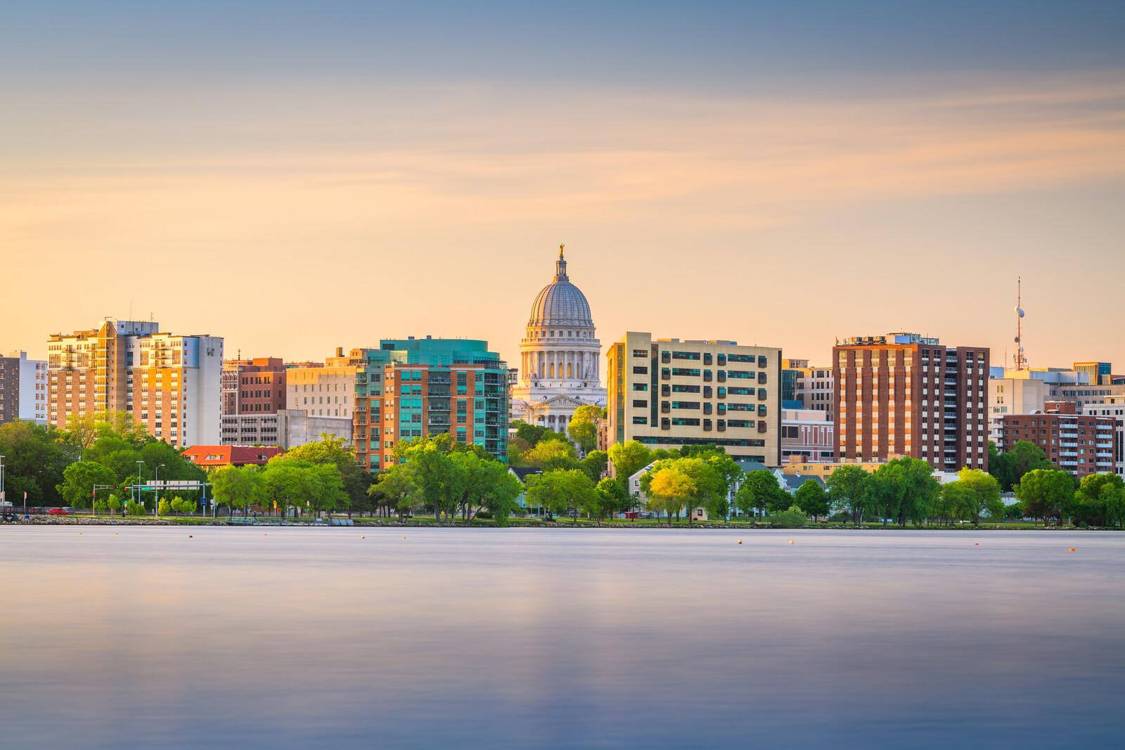 Madison, wisconsin, the downtown skyline at sunset on lake monona.