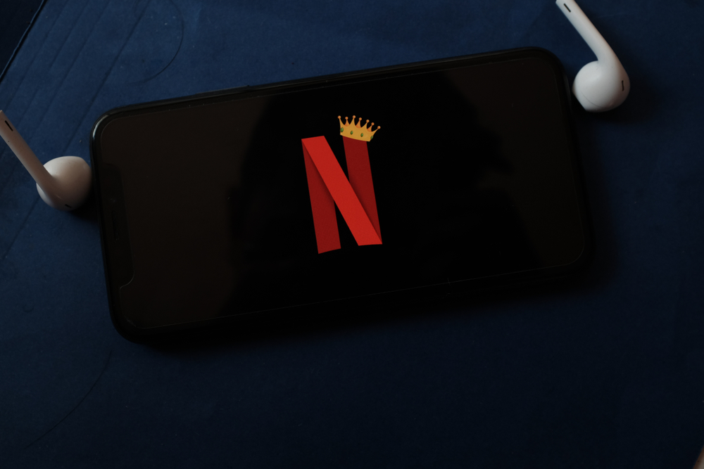 Netflix logo with a crown on a smartphone