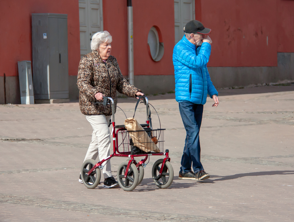 large size wheel rollator walker being used by senior woman and husband