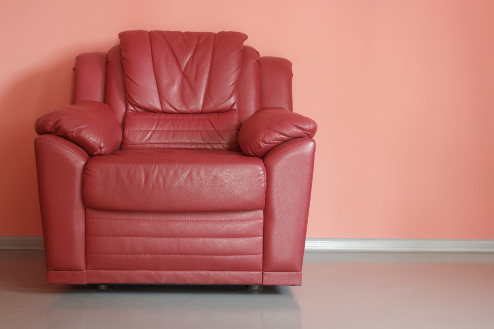 red leather sofa with battery powered recliner capabilities