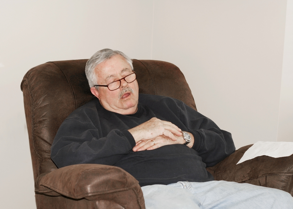 senior man on leather recliner taking a nap
