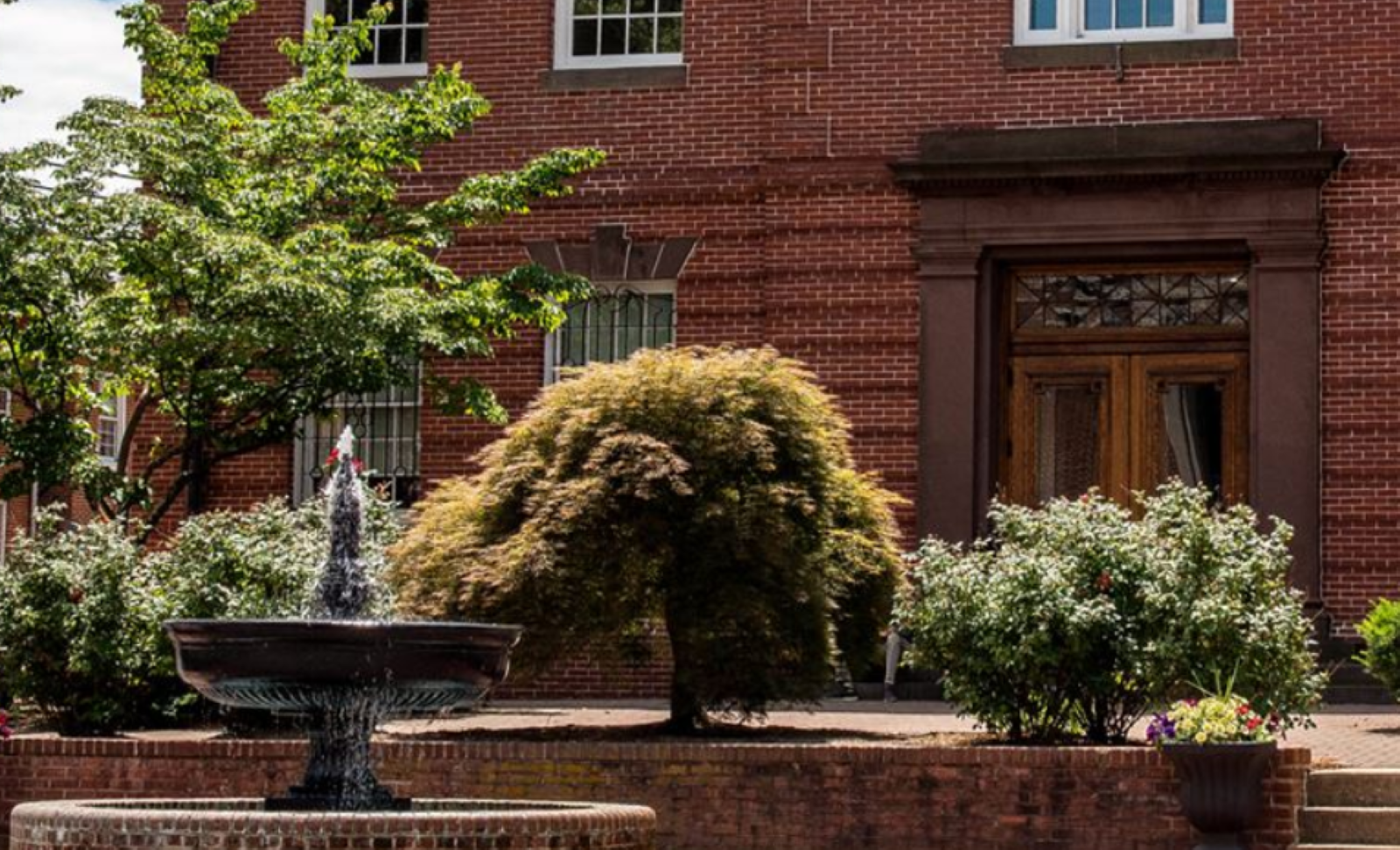 Red brick building and fountain in downtown Bel Air Maryland