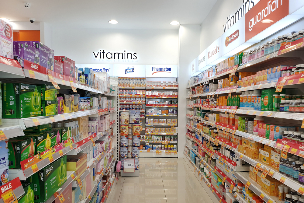 Bottles of supplements and other health products in a grocery store