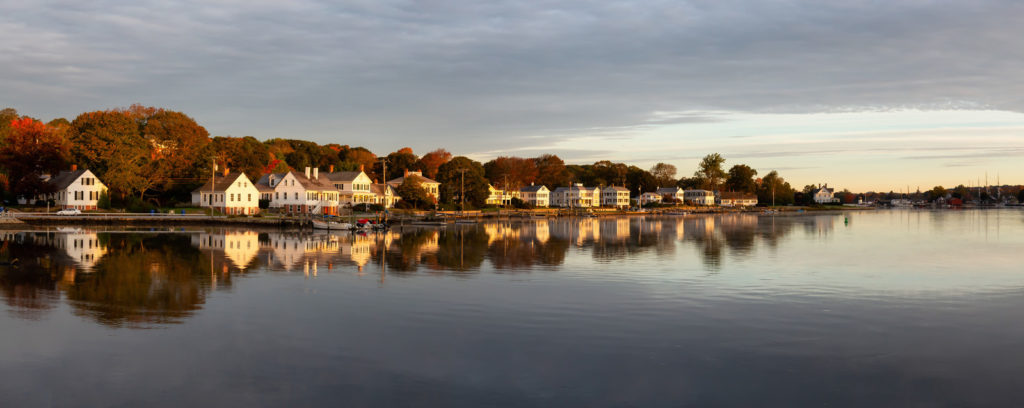 Panoramic view of residential homes by the mystic river during a vibrant sunrise. taken in mystic, stonington, connecticut,