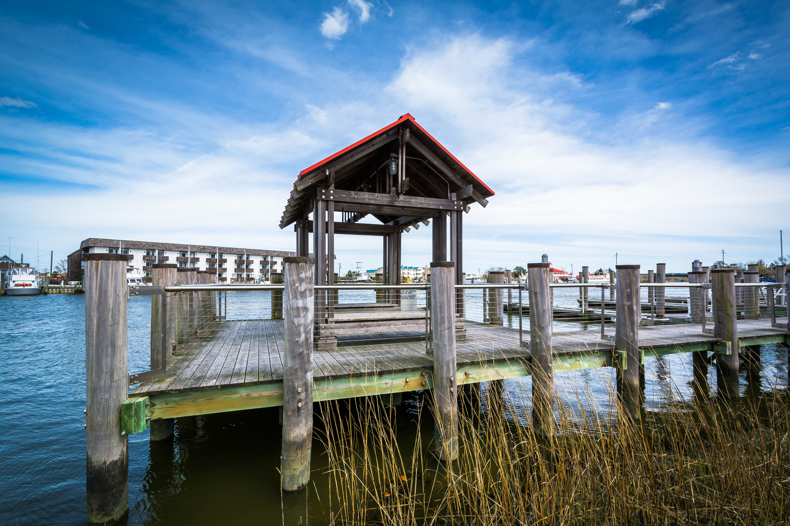 Pier in Lewes Delaware on a beautiful day with blue skies