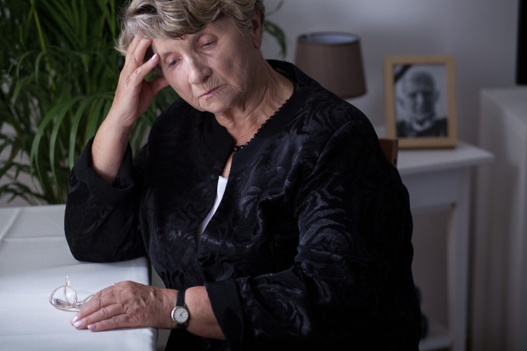 Bereavement Scams - Senior woman dressed in black mourning
