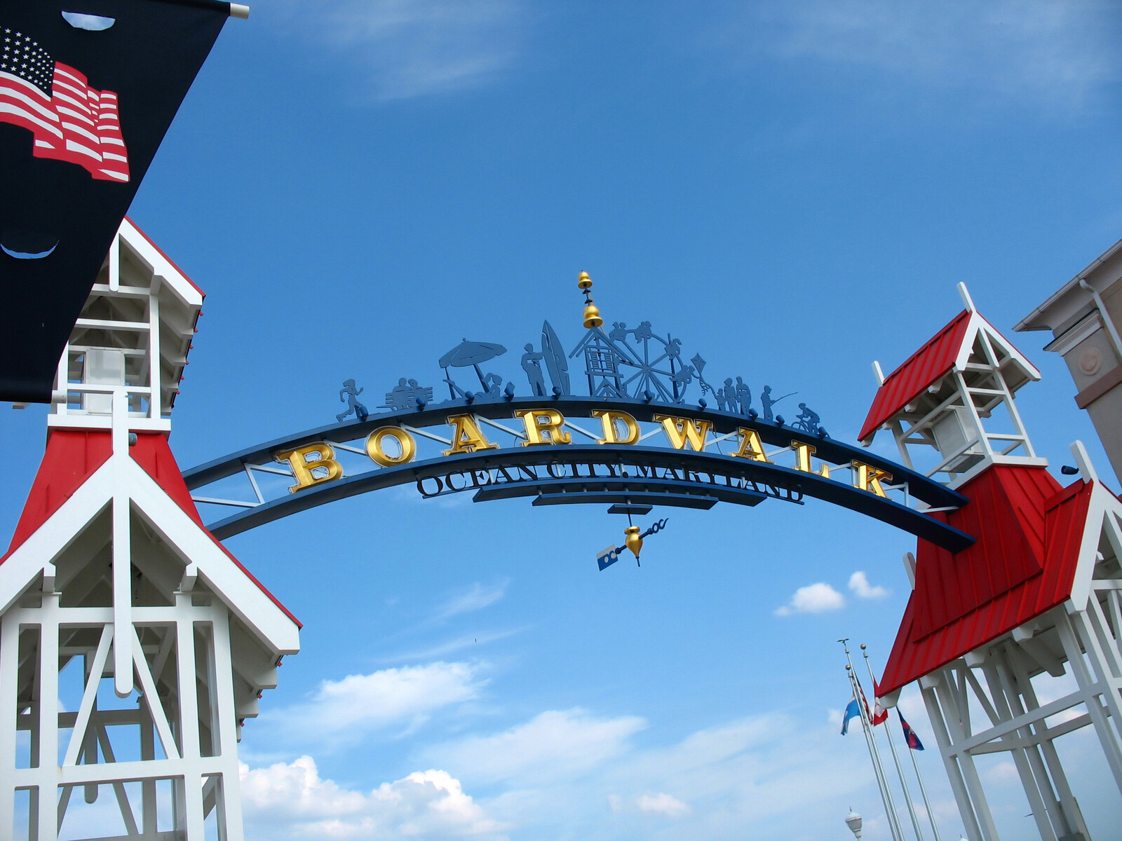 The famous public boardwalk sign overhanging the main entrance of the boardwalk in ocean city, with clear blue skies