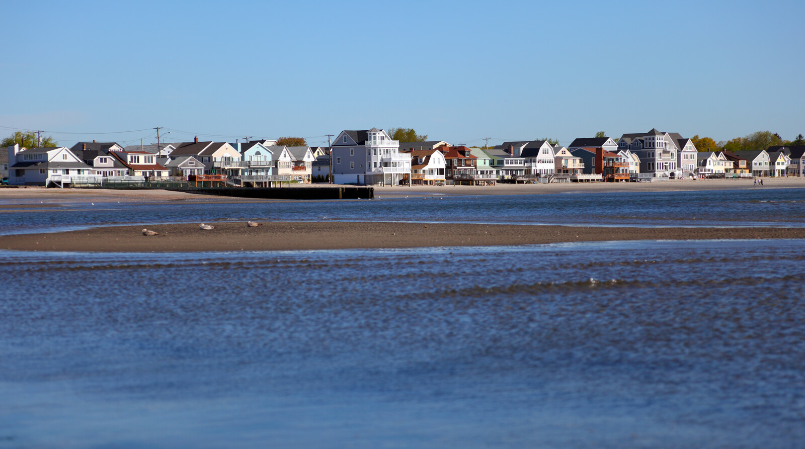Coastal town with colonial style homes sitting on the beach