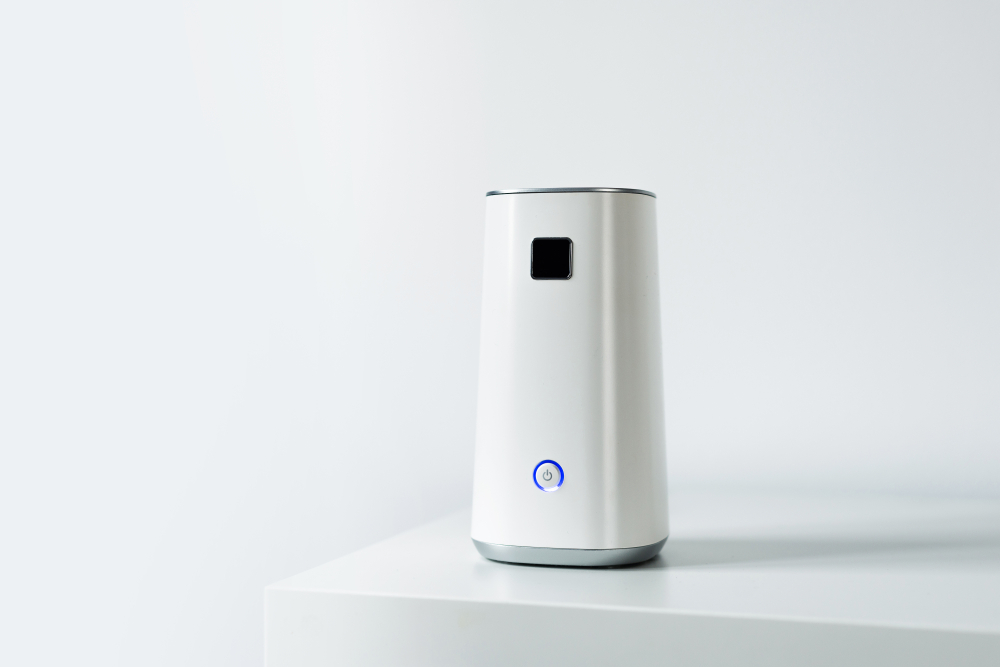 An air ionizer on a table in a white room