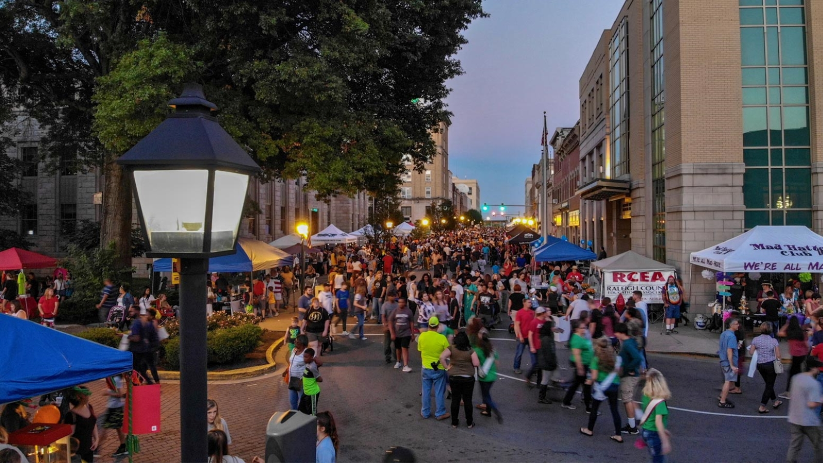 Beckley downtown during a festival at dusk with the streets filled with stands and people