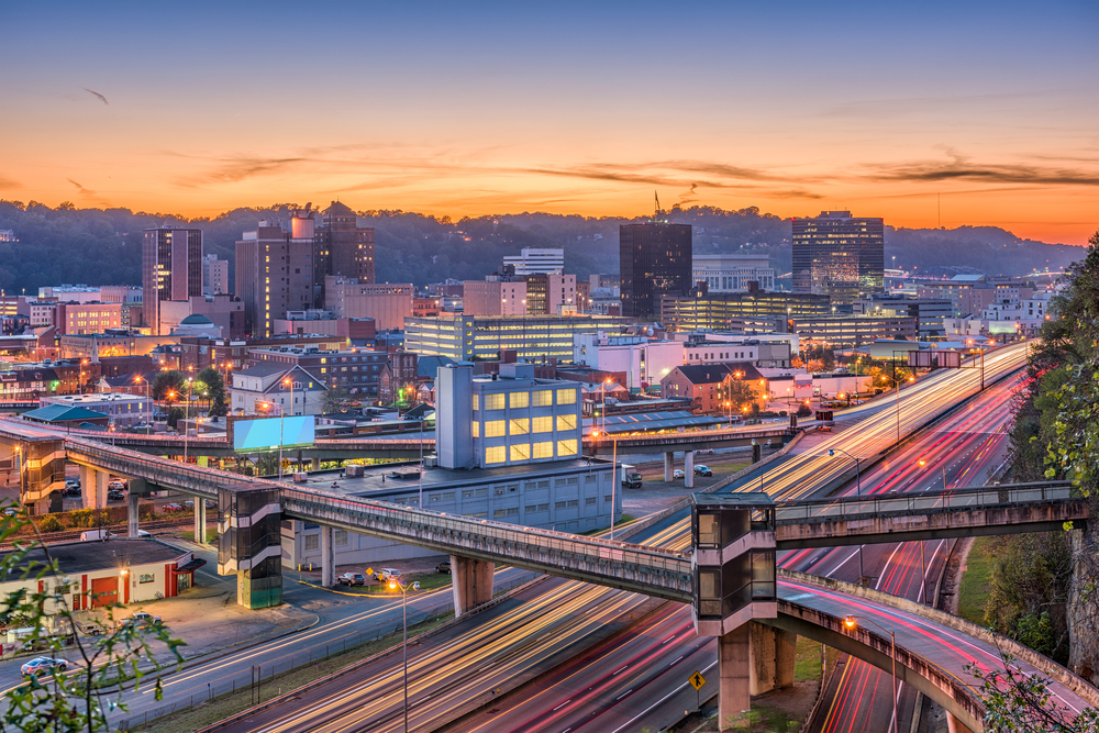 Charleston West Virginia at night showing the lights from cars and the city