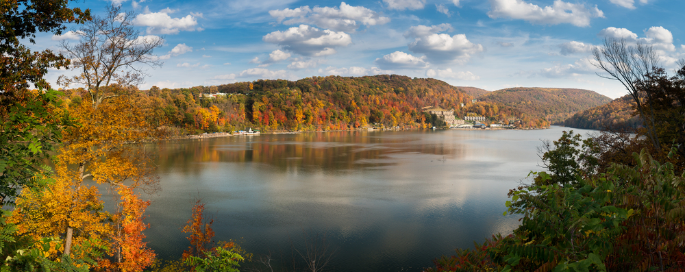 Cheat Lake in the fall showing vibrant colors of trees near the water