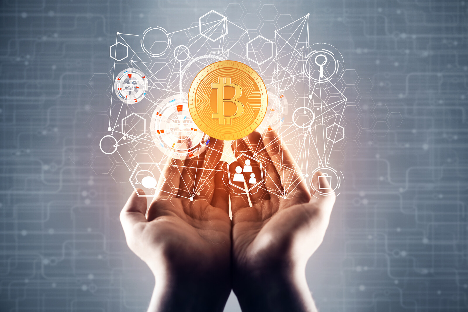 Top 5 Cryptocurrency Scams Seniors Need To Know About - hands holding bitcoin hologram with a blurry circuit hologram in the background