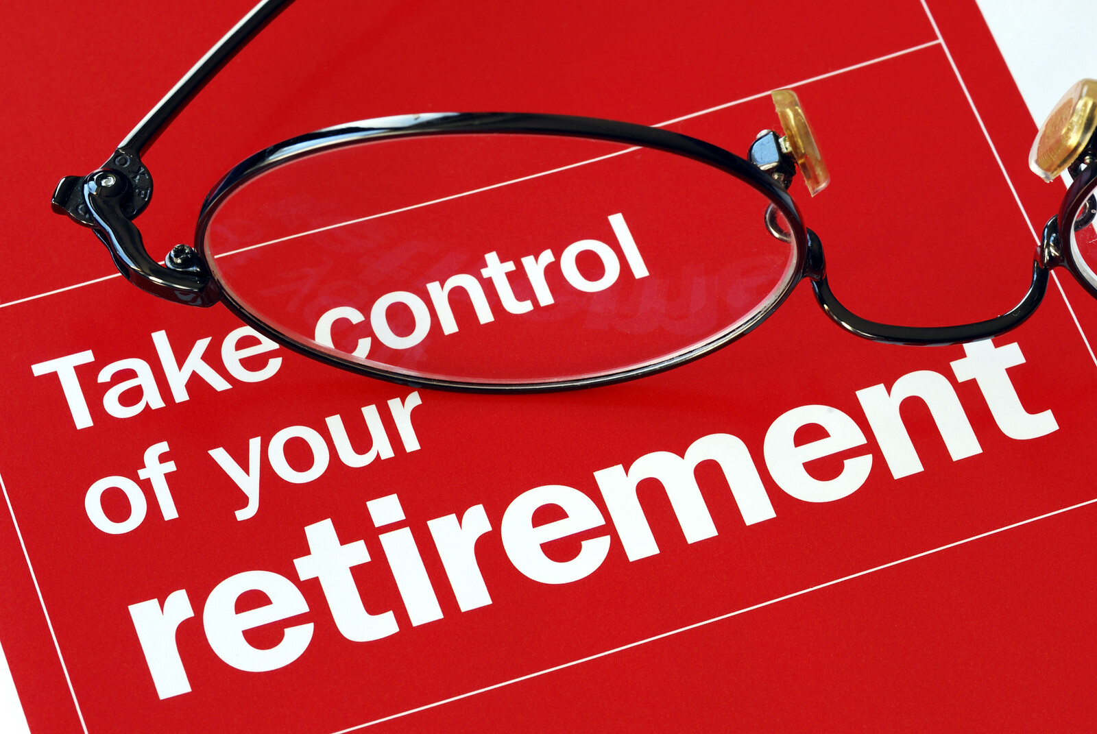 A red background with white font that says take control of your retirement with a pair of spectacles sitting on top