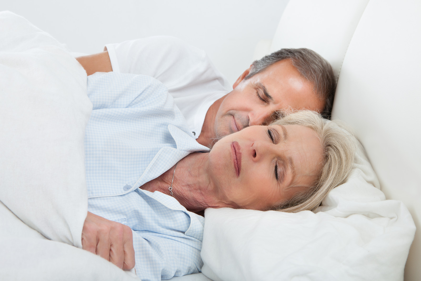 7 Ways Seniors Can Improve their Sleep Without Pills-Senior couple sleeping in bed