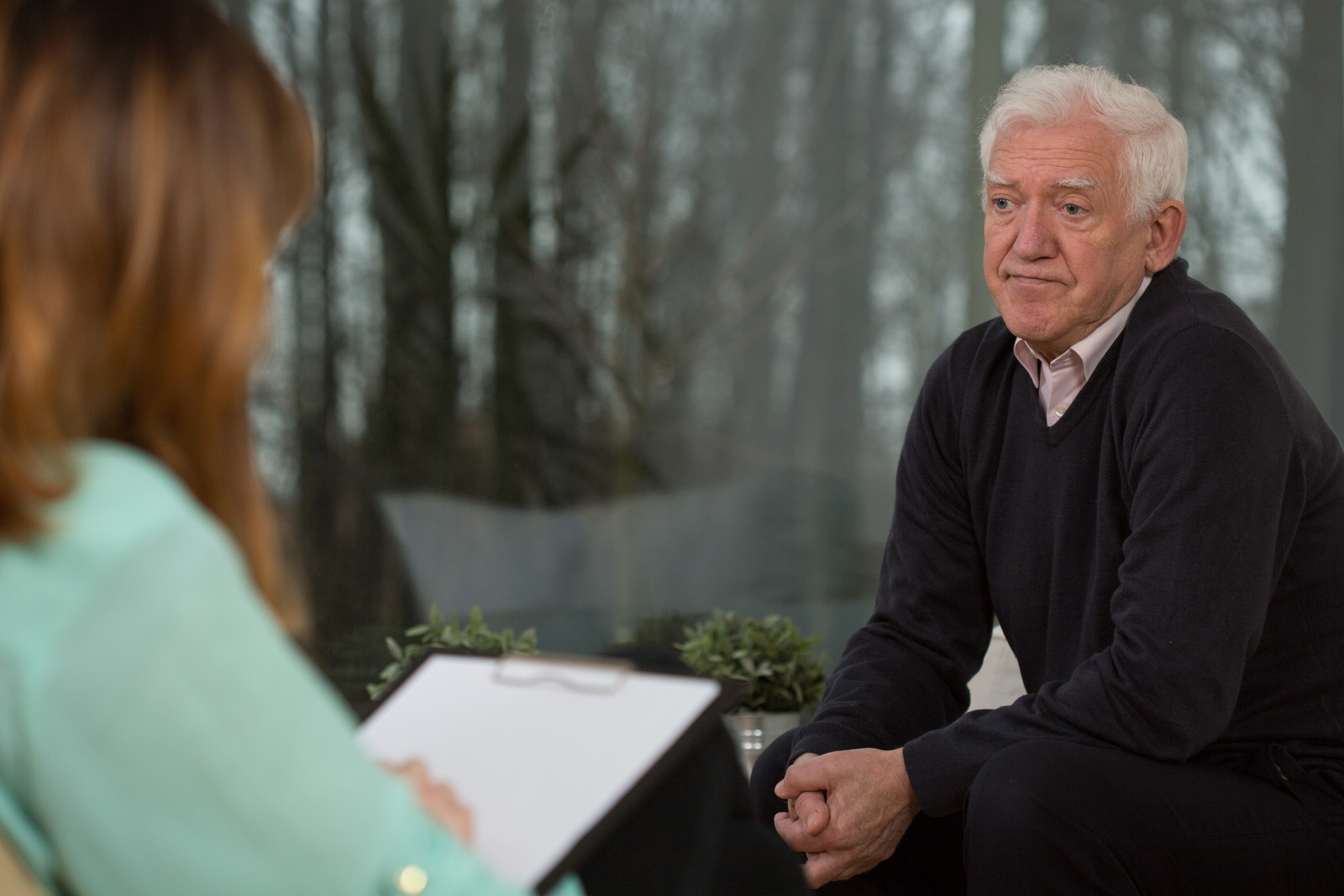 Senior man in talk therapy with a female therapist