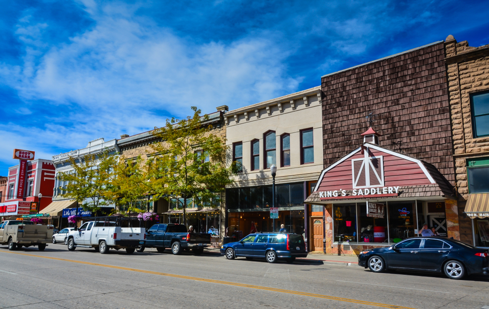A city street in Sheridan Wyoming showing cars and a blue sky