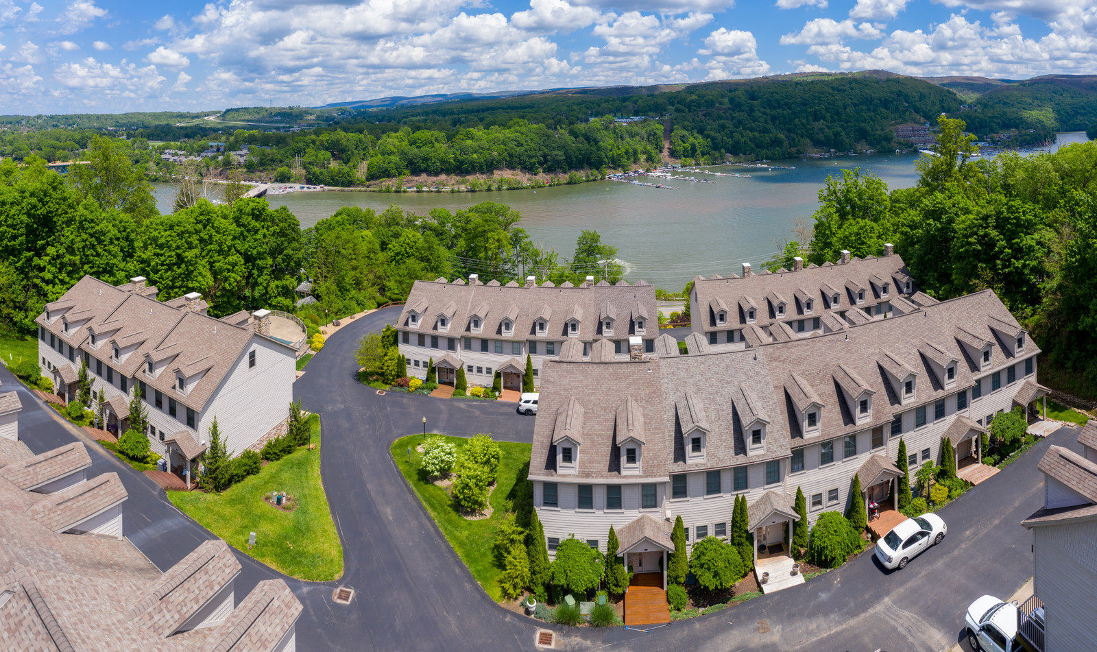 Arial view of townhouses along Cheat Lake on a sunnday with blue skies