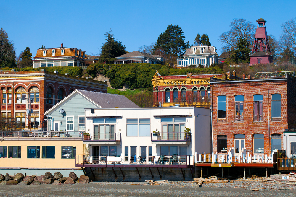 Waterfront properties in Port Townsend Washington showing bright buildings against a blue sky