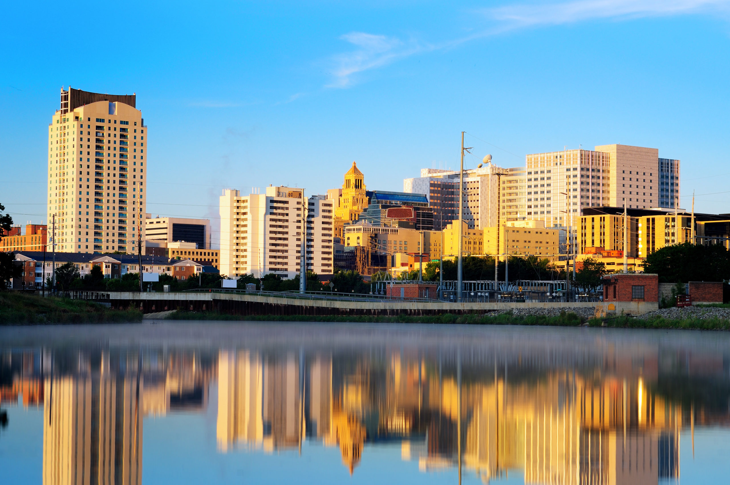 Calm morning in rochester, minnesota with a view on the famous mayo clinic with the reflection of the city on the water